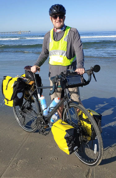 Jim Beeson with his touring bike at the Pacific Ocean